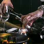 Wine being poured at bang restaurant 1 1 bang restaurant